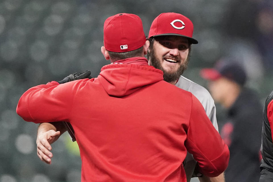 Cincinnati Reds starting pitcher Wade Miley, right, is congratulated by a teammate after piching a no-hitter in a baseball game against the Cleveland Indians, Friday, May 7, 2021, in Cleveland. (AP Photo/Tony Dejak)