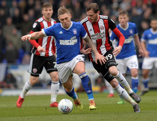 "Soccer Football - Championship - Ipswich Town vs Sheffield United - Portman Road, Ipswich, Britain - March 10, 2018 Ipswich's Martyn Waghorn in action with Sheffield United's Richard Stearman Action Images/Alan Walter EDITORIAL USE ONLY. No use with unauthorized audio, video, data, fixture lists, club/league logos or ""live"" services. Online in-match use limited to 75 images, no video emulation. No use in betting, games or single club/league/player publications. Please contact your account representative for further details."