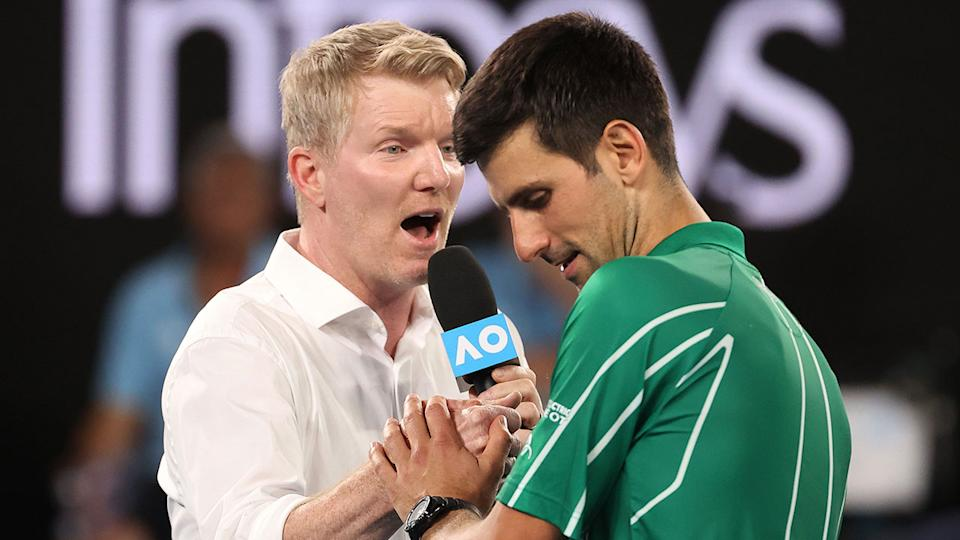 Jim Courier is seen here speaking to Novak Djokovic at the 2020 Australian Open.
