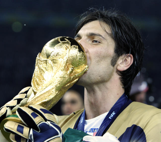 FILE - In this Sunday, July 9, 2006 filer, Italy goalkeeper Gianluigi Buffon kisses the World Cup trophy after the final of the soccer World Cup between Italy and France in the Olympic Stadium in Berlin, Sunday, July 9, 2006. Juventus captain Gianluigi Buffon has announced he is leaving the Italian club but the goalkeeper could continue playing elsewhere. Buffon, who is widely regarded as one of the best goalkeepers of all time, was expected to announce his retirement at a press conference at Allianz Stadium on Thursday, May 17, 2018. (AP Photo/Thomas Kienzle, File)