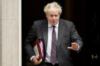 FILE - In this Sept. 15, 2021, file photo, Britain's Prime Minister Boris Johnson leaves 10 Downing Street as he makes his way to Parliament to attend the weekly Prime Minister Questions session, in London. Britain's Conservative government is hoping a combination of relatively high vaccination rates and common-sense behavior will keep a lid on coronavirus infections this fall and winter and avoid the need for restrictive measures. That plan employs a lighter touch than most nations. (AP Photo/Alberto Pezzali, File)