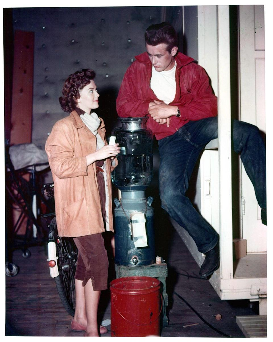 <p>There are fewer iconic outfits than the one James Dean wore in <em>Rebel Without a Cause</em>. Paired with a crisp, white t-shirt and red jacket, Dean wore dark wash denim to suit his broody character. </p>