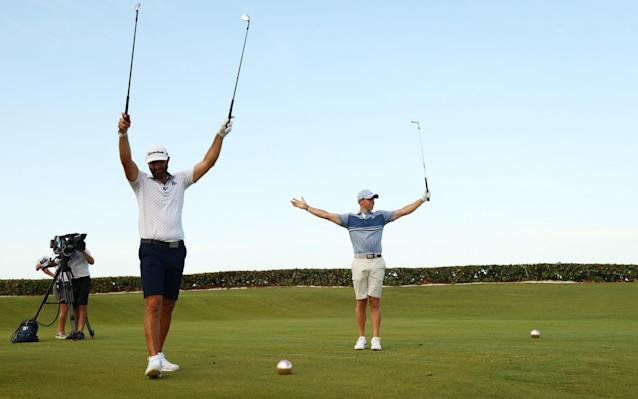 Rory McIlroy and Dustin Johnson won the nearest-the-pin finale on the first extra hole - GETTY IMAGES