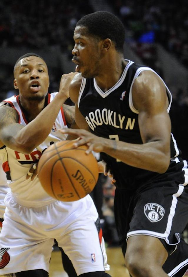 Brooklyn Nets' Joe Johnson (7) drives against Portland Trail Blazers' Damian Lillard, left, during the first half of an NBA basketball game in Portland, Ore., Wednesday, Feb. 26, 2014. (AP Photo/Greg Wahl-Stephens)