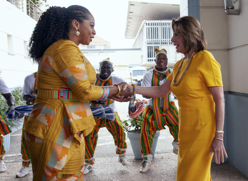 FILE - In this Wednesday, July 31, 2019 file photo, U.S. House Speaker Rep. Nancy Pelosi, D-Calif., shakes hands with the Hon. Sarah Adwoa Sarfo outside Ghana's Parliament in Accra, Ghana, during a visit by a U.S. congressional delegation. On Friday, Aug. 2, 2019, The Associated Press reported on photos circulating online, made during this visit, incorrectly asserting that the House Democrats were vacationing in Venice, Italy. The diplomatic trip was made by U.S. legislators to mark the 400th anniversary of the slave trade. (AP Photo/Christian Thompson)