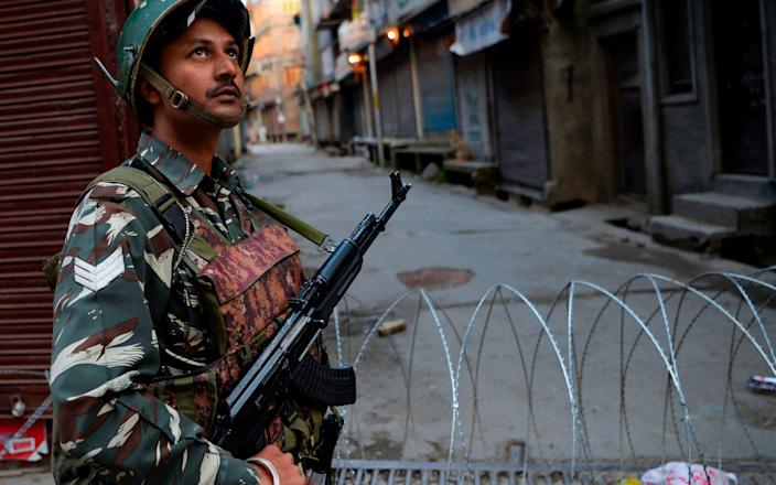 An Indian security officer stands guard in Srinagar - AFP