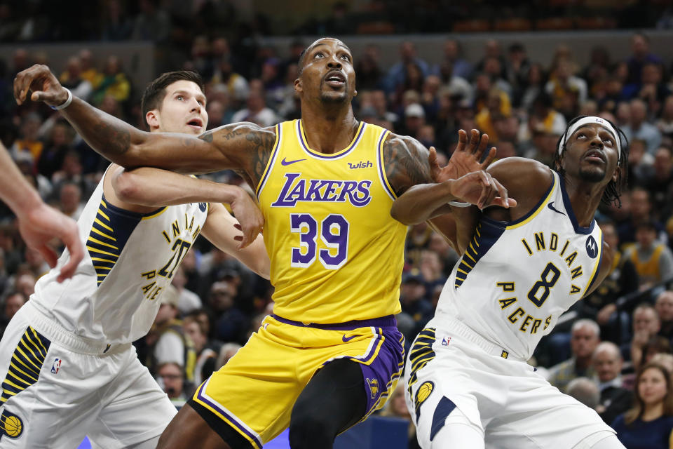 Dec 17, 2019; Indianapolis, IN, USA; Los Angeles Lakers center Dwight Howard (39) battles for rebounding position against Indiana Pacers guard Justin Holiday (8) and forward Doug McDermott (20) during the first quarter at Bankers Life Fieldhouse. Mandatory Credit: Brian Spurlock-USA TODAY Sports