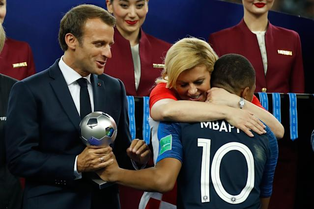 France's Kylian Mbappe receives the silver ball for best young player from French President Emmanuel Macron and Croatian President Kolinda Grabar-Kitarovic during the medals ceremony after the Russia 2018 World Cup final. (Getty Images)