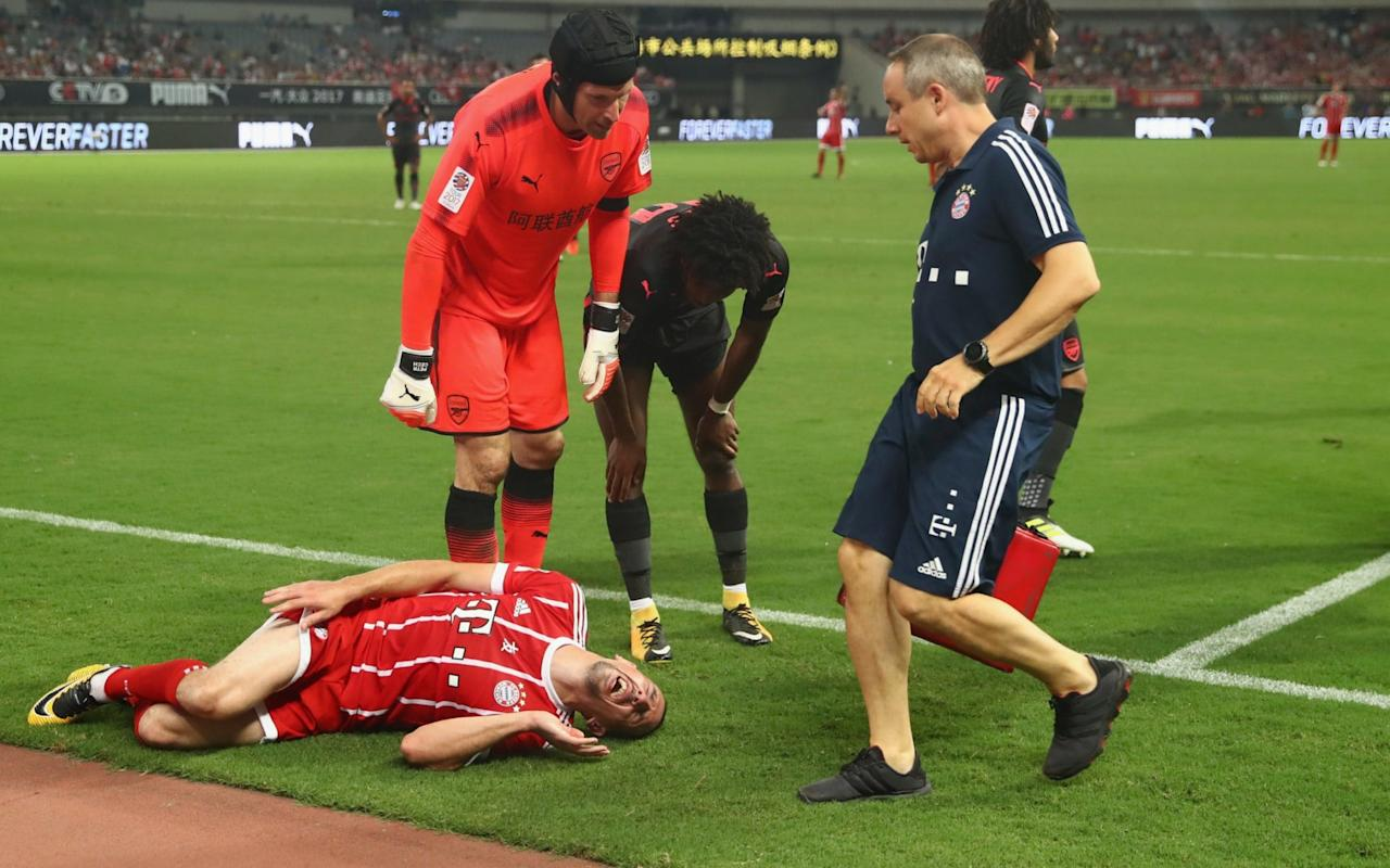 Arsenal finally got the beatingof Bayern Munich, albeit in the surroundings of a pre-season friendly in Shanghai. Alex Iwobi grabbed a last-gaspequaliser for Arsene Wenger's side by heading past ChristianFrüchtl in normal timeto send the International Champions Cup into penalties. Iwobi, one of a number of second-half substitutes, then scored in the shoot-out while Nacho Monreal and Aaron Ramsey were also on target. Renato Sanches struck the bar with his effort whileJuan Bernat saw his saved byEmiliano Martinez to ensure Arsenal of a 3-2 win on penalties. Bayern Munich, who had beaten Arsenal 5-1 on two occasions in the Champions League last season, looked like causing Arsenal further problems when they took an early lead with a Robert Lewandowski penalty after nine minutes. Arsenal celebrate after winning the International Champions Cup The Bundesliga champions would have added to their lead were it not for the brilliance of Petr Cech. Arsenal's record-signing AlexandreLacazette had a great chance to level midway midway through the first half but saw his effort saved well by Bayern keeperTom Starke. A raft of substitutions disrupted the flow of the contest in the second half but Iwobi impressed in his cameo role as Arsenal went on to lift the trophy. Arsenal will next face Chelsea this Saturday,July 22at the Bird's Nest Stadium in Beijing. 3:05PM Arsenal win 3-2 on pens Sorry for the delay, but for technical issues meant we weren't able to bring you the penalties live. What I can say is that Arsenal have won 3-2 with Ramsey, Monreal and Iwobi all on target for Wenger's side. Elneny was the only player to miss with Früchtl guessing the right way. Sanches and Bernat both missed their efforts for Bayern. Sanches powered his shot onto the bar while Martinez saved from Bernat to ensure Arsenal of the three points in the first match of the International Champions Cup. 2:30PM But wait, there's more. There are penalties We are not done yet people. 2:26PM FT Arsenal 1 Bayer