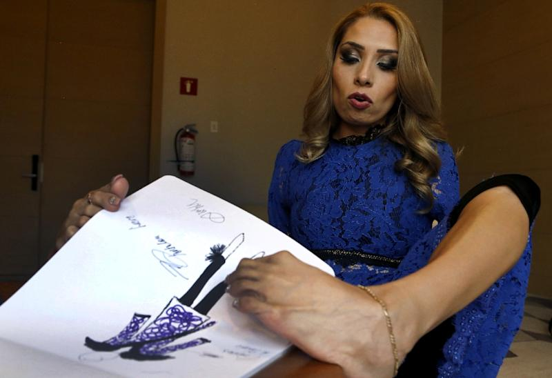 No arms, no problem: Mexican fashionista Adriana Macias has forged a path to success by designing apparel with her feet (AFP Photo/ULISES RUIZ)