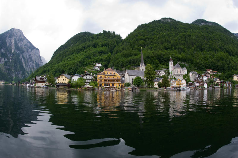 This photo taken on Thursday, June 16, 2011, shows the Upper Austrian town of Hallstadt. After taking photos and collecting other data on the village while mingling with the tourists, Chinese architects plan to rebuild Hallstatt in all topsy-turvy glory in far-away  Guandong province _ a project that residents here see with mixed emotions. (AP Photo/Kerstin Joensson)