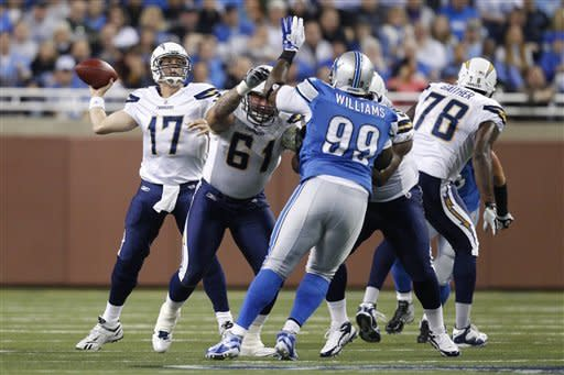 San Diego Chargers quarterback Philip Rivers (17) passes the ball as center Nick Hardwick (61) blocks Detroit Lions defensive tackle Corey Williams (99) in the first quarter an NFL football game in Detroit, Saturday, Dec. 24, 2011. (AP Photo/Rick Osentoski)