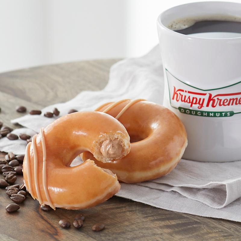 Original Filled Coffee Kreme donut on tabletop with coffee in background