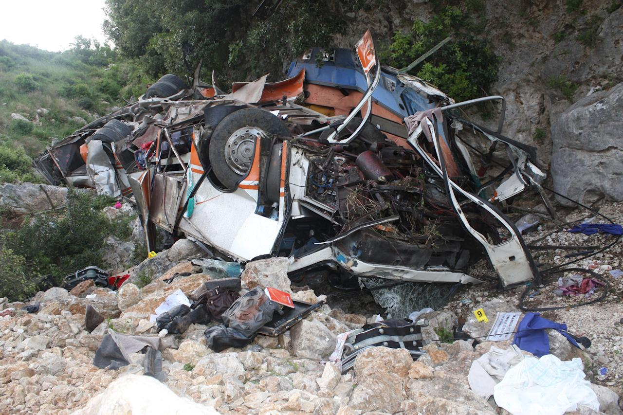 The debris of a bus lies at the bottom of a cliff near Himare southern Albania on Monday, May 21, 2012. The bus accident killed a number of people and injured tens of others authorities said. Local prefect Edmond Velcani said the bus driver was among the people killed. The bus had been heading from the city of Elbasan to the southern city of Saranda. Police spokeswoman Klejda Plangarica said the bus fell some 80 meters (yards) off the road in Qafa e Vishes near the town of Himare, 137 miles (220 kilometers) south of the capital, Tirana, on Monday afternoon. (AP Photo)