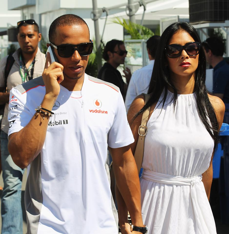 MONTREAL, CANADA - JUNE 10:  Lewis Hamilton of Great Britain and McLaren Mercedes and his girlfriend Nicole Scherzinger of the Pussycat Dolls arrive in the paddock before the Canadian Formula One Grand Prix at the Circuit Gilles Villeneuve on June 10, 2012 in Montreal, Canada.  (Photo by Mark Thompson/Getty Images)