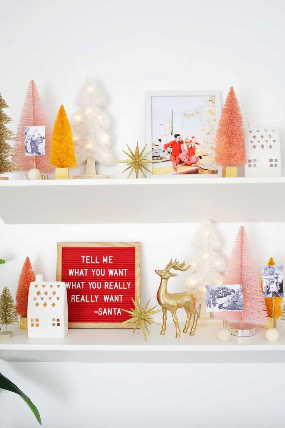 "<p>If you love the idea of changing up your decor as the season progresses, add a colorful letter board into the mix. It's the perfect place for season's greetings, snippets of holiday song lyrics, and more. </p><p><em>See more at <a href=""https://abeautifulmess.com/use-these-5-items-to-create-an-easy-holiday-display/"" rel=""nofollow noopener"" target=""_blank"" data-ylk=""slk:A Beautiful Mess"" class=""link rapid-noclick-resp"">A Beautiful Mess</a>.</em></p><p><a class=""link rapid-noclick-resp"" href=""https://www.amazon.com/Felt-Inches-Changeable-Include-Plastic/dp/B07K1FBN7Y?tag=syn-yahoo-20&ascsubtag=%5Bartid%7C10072.g.34484299%5Bsrc%7Cyahoo-us"" rel=""nofollow noopener"" target=""_blank"" data-ylk=""slk:SHOP LETTER BOARD"">SHOP LETTER BOARD</a></p>"