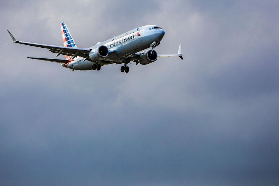 An American Airlines Group Inc. Boeing Corp. 737 Max 8 aircraft approaches to land at Miami International Airport (MIA) in Miami, Florida, U.S., on Tuesday, March 12, 2019. Since shortly after the dawn of the jet age, the world has followed the U.S.'s lead on aviation safety. Now, in a remarkable rebuke, nations from the U.K. to Australia have rejected public reassurances from the Federal Aviation Administration and grounded Boeing Co.'s 737 Max jet. Photographer: Scott McIntyre/Bloomberg via Getty Images