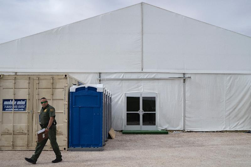 A US Border Patrol agent walks by a new temporary holding facility opened by Customs and Border Protection personnel on the US-Mexico border in El Paso, Texas