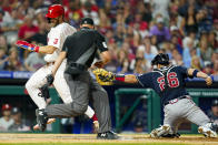 Philadelphia Phillies' Bryce Harper, left, scores a run as he gets past the tag by Atlanta Braves catcher Stephen Vogt, right, during the fifth inning of a baseball game, Friday, July 23, 2021, in Philadelphia. (AP Photo/Chris Szagola)