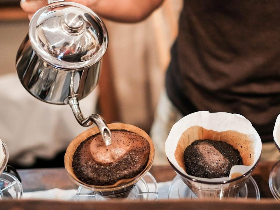 brewing black coffee pour over cup filtered barista shutterstock_473186929