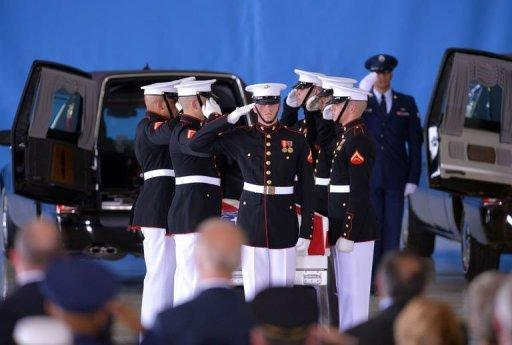 """US Marines salute during a ceremony marking the return to the US of the remains of the four Americans killed in an attack in Benghazi, Libya, at the Andrews Air Force Base in Maryland. President Barack Obama vowed Friday to """"stand fast"""" against spreading anti-US violence raging in the Arab world, as he mourned the four slain Americans after their remains were flown home"""