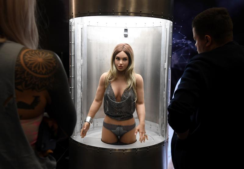 LAS VEGAS, NEVADA - JANUARY 22: Attendees watch a Harmony RealDoll customizable sex robot by Abyss Creations at the 2020 AVN Adult Entertainment Expo at the Hard Rock Hotel & Casino on January 22, 2020 in Las Vegas, Nevada. (Photo by Ethan Miller/Getty Images)