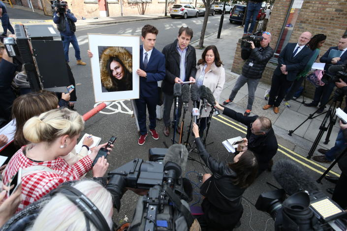 Nadim and Tanya Ednan-Laperouse, with their son Alex, speaking to the media outside West London Coroners Court, Friday Sept. 28, 2018, following the inquest into the death of Natasha Ednan-Laperouse, 15, seen on poster, who died after suffering a fatal allergic reaction on a flight from London to Nice after eating a Pret A Manger sandwich at Heathrow Airport. Natasha's father, Nadim, said Friday he hoped the death of their daughter could serve as a watershed moment to make meaningful changes to allergy labelling on food packaging. (Jonathan Brady/PA via AP)