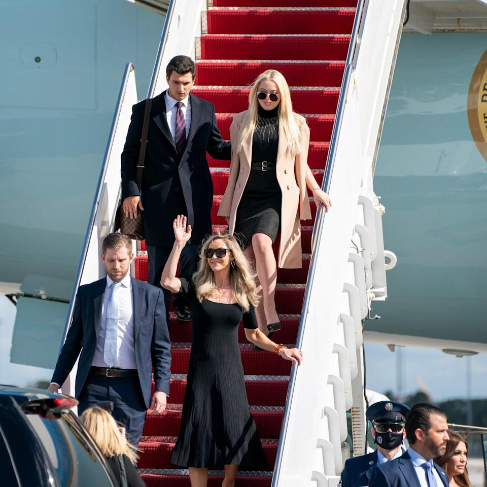 Tiffany Trump with her finance, Michael Boulos, top, and Eric Trump and his wife Lara Trump and Donald Trump Jr., and his girlfriend Kimberly Guilfoyle, bottom right, arrive at Palm Beach International Airport  - AP