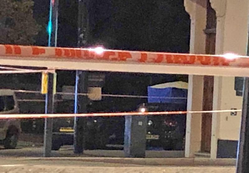 A police tent in Sydenham Road, south-east London, after a man in his twenties was found with gunshot wounds and died at the scene on Sunday afternoon.