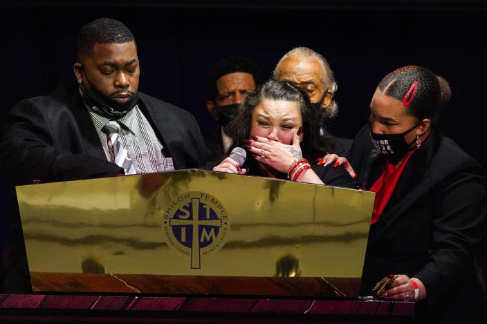 CORRECTS SPELLING OF FIRST NAME TO ARBUEY, NOT AUBREY - Katie and Arbuey Wright, parents of Daunte Wright, cry as the speak during funeral services of Daunte Wright at Shiloh Temple International Ministries in Minneapolis, Thursday, April 22, 2021. Wright, 20, was fatally shot by a Brooklyn Center, Minn., police officer during a traffic stop. (AP Photo/Julio Cortez, Pool)