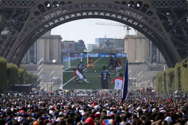 Supporters of the French soccer team watch the World Cup final between France and Croatia, Sunday, July 15, 2018 next to the Eiffel Tower in Paris. (AP Photo/Bob Edme)