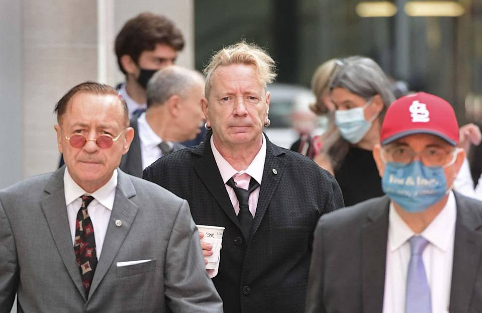 John Lydon, aka Johnny Rotten, centre, arrives at court (Ian West/PA) (PA Wire)