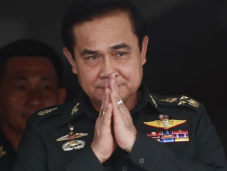 Thailand's newly appointed Prime Minister Prayuth Chan-ocha gestures in a traditional greeting during his visit to the 2nd Infantry Battalion, 21st Infantry Regiment, Queen's Guard in Chonburi province