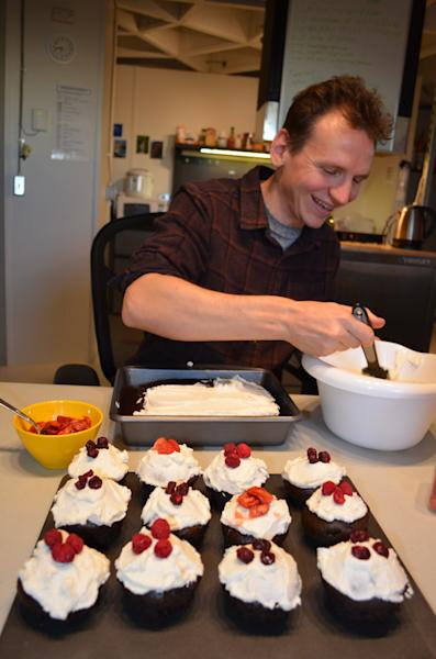 In this May 13, 2013 photo provided by the University of Hawaii, research space scientist Oleg Abramov frosts cake inside a simulated Martian base dome on Mauna Loa, Hawaii. Six researchers have spent the past four months living in a small dome on a barren Hawaii lava field at 8,000 feet, trying to figure out what foods astronauts might eat on Mars and during deep-space missions. (AP Photo/University of Hawaii, Sian Proctor)