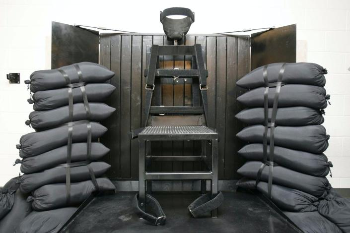 """<span class=""""caption"""">The execution chamber at Utah State Prison used in the U.S.'s last firing squad execution.</span> <span class=""""attribution""""><a class=""""link rapid-noclick-resp"""" href=""""https://newsroom.ap.org/detail/FiringSquad-Appeal/607069faa7ea4355b6a0646ff1f0efdd/photo?Query=firing%20squad%20prison&mediaType=photo&sortBy=arrivaldatetime:desc&dateRange=Anytime&totalCount=197&currentItemNo=11"""" rel=""""nofollow noopener"""" target=""""_blank"""" data-ylk=""""slk:AP Photo/Trent Nelson, Pool, File"""">AP Photo/Trent Nelson, Pool, File</a></span>"""
