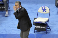 Kentucky head coach John Calipari yells to his team during the first half of an NCAA college basketball game against LSU in Lexington, Ky., Saturday, Jan. 23, 2021. (AP Photo/James Crisp)