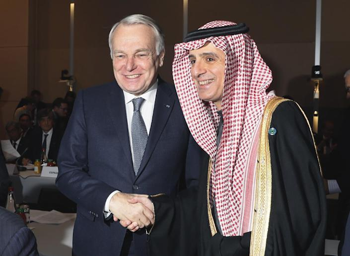 French Minister of Foreign Affairs Jean-Marc Ayrault, left, greets his Saudi counterpart Adel Al-Jubeir at the opening of the Mideast peace conference in Paris, Sunday, Jan. 15, 2017. Fearing a new eruption of violence in the Middle East, more than 70 world diplomats gathered in Paris on Sunday to push for renewed peace talks that would lead to a Palestinian state. (Thomas Samson/Pool Photo via AP)