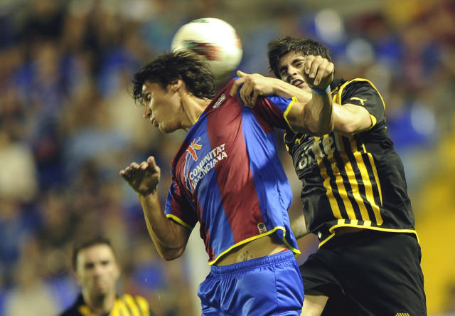 Levante's Rafa Jorda (L) vies with Penarol's Mac Echaen (R) during their Agora Trophy football match at the Ciudad de Valencia Stadium, in Valencia on August 2, 2011. AFP PHOTO / JOSE JORDAN (Photo credit should read JOSE JORDAN/AFP/Getty Images)
