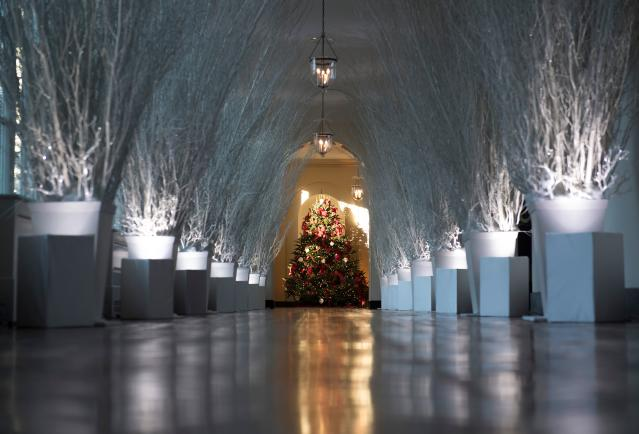 <p>Christmas decorations are seen in the East Wing during a preview of holiday decorations at the White House in Washington, D.C. on Nov. 27, 2017. (Photo: Saul Loeb/AFP/Getty Images) </p>