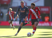 Arsenal's Rob Holding, left and Southampton's Che Adams battle for the ball during the FA Cup fourth round soccer match between Southampton and Arsenal, at St. Mary's Stadium, in Southampton, England, Saturday Jan. 23, 2021. (Catherine Ivill/PA via AP)