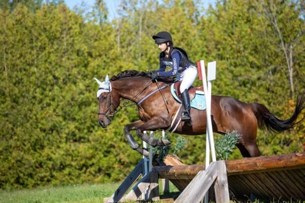 Ali Neustaedter competing. She's the owner of The Thrifty Equine, an online consignment store for all things riding.