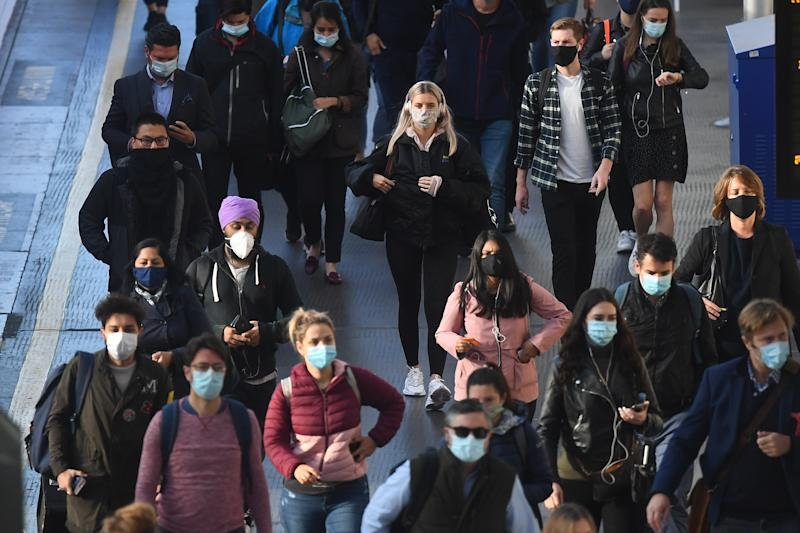 Commuters at Waterloo Station, in London, at 08:54hrs on Thursday, after Prime Minister Boris Johnson announced a range of new restrictions to combat the rise in coronavirus cases in England.