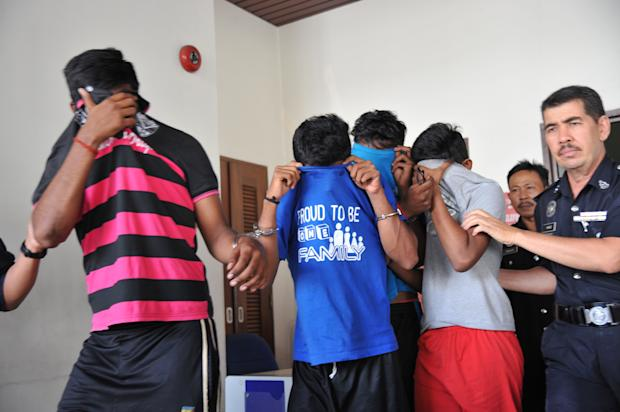 The four teenagers involved in the death of 18-year-old T. Nhaveen are pictured arriving at the Penang court on June 19, 2017. — Picture by KE Ooi