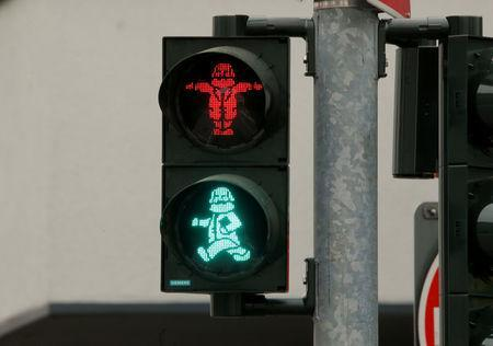 FILE PHOTO: An image of German philosopher Karl Marx is seen in a traffic light for passengers in his hometown in Trier, Germany, April 13, 2018. REUTERS/Wolfgang Rattay/File Photo