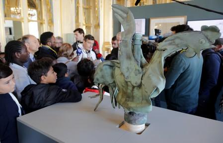 "The iconic copper rooster, which was perched at the top of the spire of Notre-Dame Cathedral for more than a century is displayed at the exhibition ""Revoir Notre-Dame de Paris\"