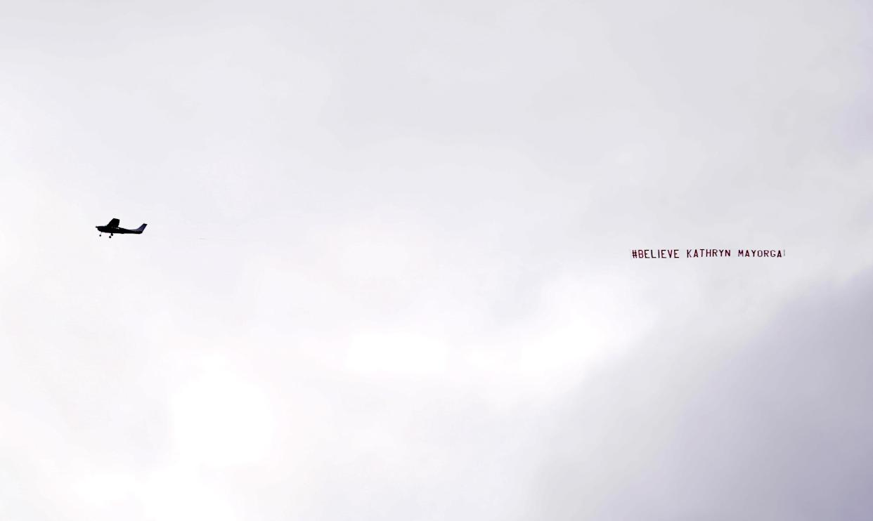 A banner reading '#Believe Kathryn Mayorga' flies over the staduium during the Premier League match at Old Trafford, Manchester. Picture date: Saturday September 11, 2021.