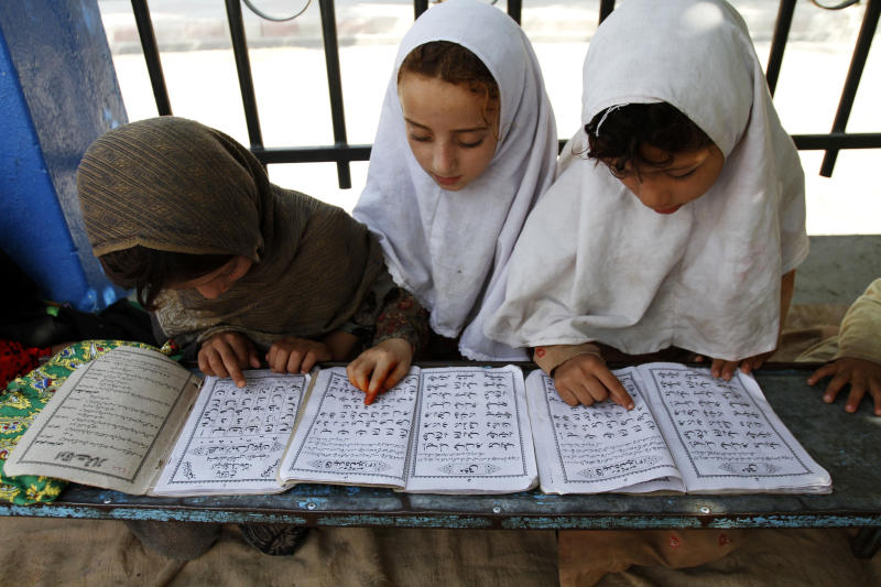 Afghan girls read the Quran during the Muslim holy month of Ramadan at a mosque in the city of Jalalabad, the provincial capital of Nangarhar province, east of Kabul, Afghanistan, Sunday, July 22, 2011. Muslims from Morocco to Afghanistan are experiencing the toughest Ramadan in more than three decades with no food or drink, not even a sip of water, for 14 hours a day during the hottest time of the year. (AP Photo/Rahmat Gul)