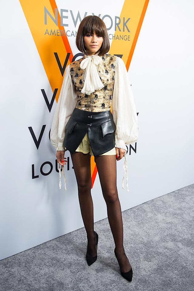 <p>Zendaya never does anything by halves so what better way to dress up a Victoriana blouse and waistcoat than with a barely there leather skirt?<br /><i>[Photo: Getty]</i> </p>