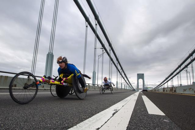 Wheelchair racers ride across the Verrazano-Narrows Bridge during the New York City Marathon in New York, November 3, 2013. REUTERS/Lucas Jackson (UNITED STATES - Tags: SPORT ATHLETICS TPX IMAGES OF THE DAY)