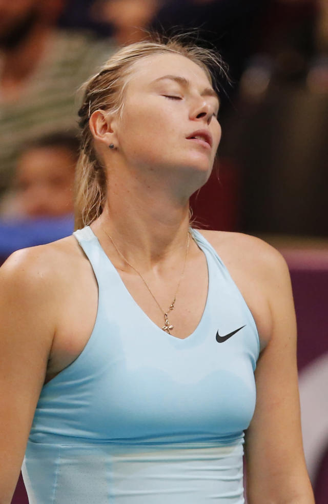 Maria Sharapova of Russia reacts after losing a point for the match to Anastasia Pavlyuchenkova of Russia during the semi final match of the 22st Gaz de France WTA Open 2014 tennis tournament at Coubertin stadium, in Paris, Saturday, Feb. 1, 2014. (AP Photo/Jacques Brinon)